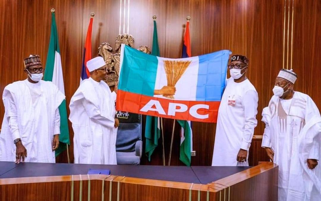 President Buhari receives Ize-Iyamu, presents party flag …charges party to work in unison for Ize-Iyamu's victory